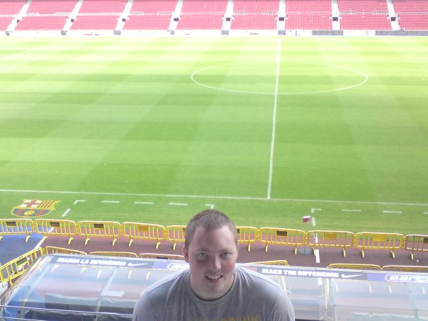 Johnny at Barcelona's Nou Camp stadium - combining his twin passions of travel and football!